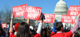 Activists Hold Red Signs that Say Equality Now
