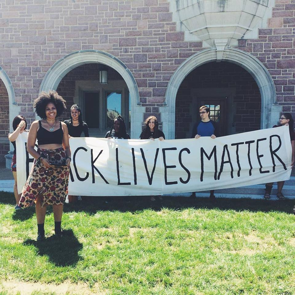 Mimi Borders stands in front of a banner that reads Black Lives Matters