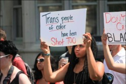 "Depiction of sign at protest reading ""Trans people of color have been shot too."""
