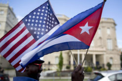 Eduardo Clark holds American and Cuban flags across the street from the Cuban embassy in Washington, D.C., U.S., on Monday, July 20, 2015. A diplomatic freeze that stretched five decades, outlasting the Cold War and nine U.S. presidencies, formally ends Monday when Cuba and the U.S. reopen embassies. Cuban Foreign Minister Bruno Rodriguez will attend a flag-raising ceremony at the Cuban chancery in Washington before meeting Secretary of State John Kerry, who will travel to Havana at a later date. Photographer: Andrew Harrer/Bloomberg via Getty Images  From: http://www.msnbc.com/rachel-maddow-show/obamas-cuba-policy-enjoys-broad-bipartisan-backing