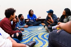 Young People For community members discussing self care at the recent Young People For national conference.